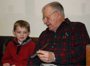 A.G. Russel teaching knife safety to a youth